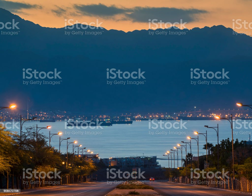 Scenic view on Jordanian mountains and anchored ships at the gulf of Aqaba (Red Sea) stock photo