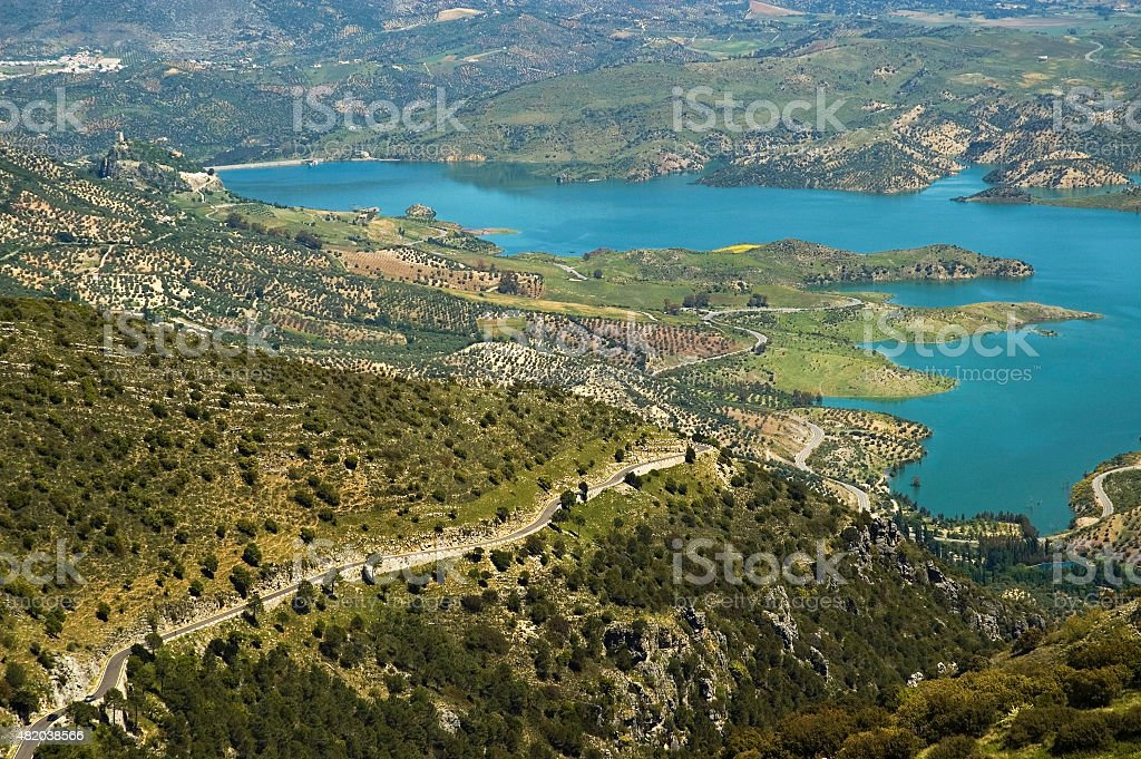 Scenic view over Lake Zahara along rolling hills, Andalusia, Spain stock photo