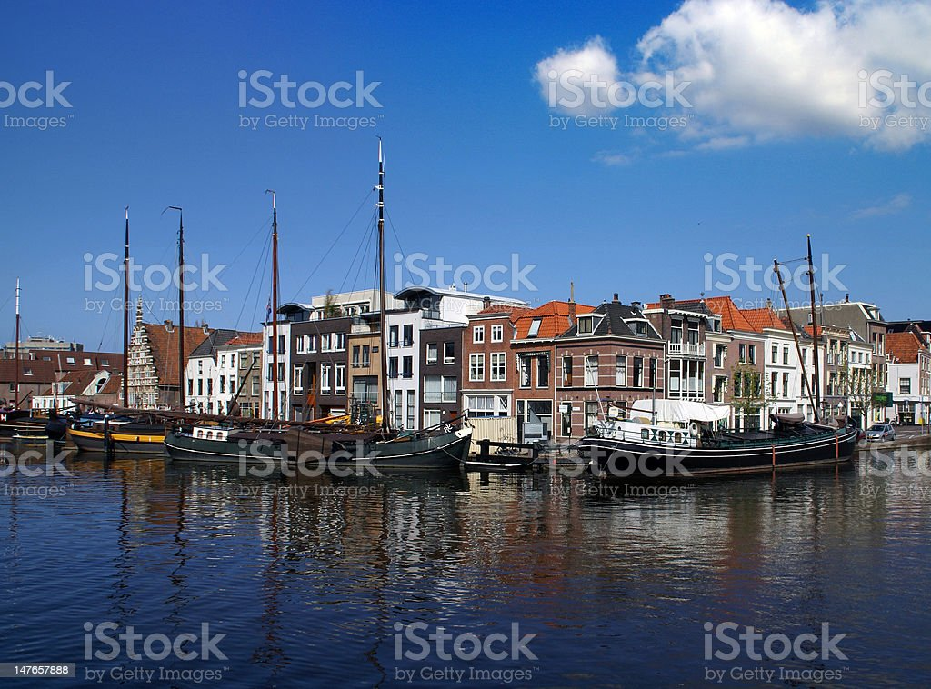Scenic view over Leiden with old harbor and historical boats stock photo