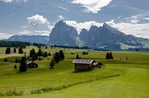 istock Scenic views of Cottages in partly sunny weather, Picturesque. Alpe di Siusi or Seiser Alm with Sassolungo and Langkofel mountain group, South Tyrol, Italy 1195542722