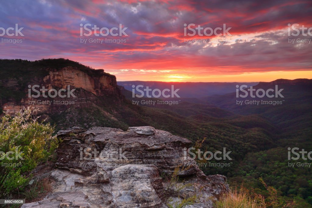 Scenic views over Jamison Valley with a vivid red dawn sky stock photo