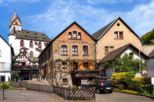 Scenic village Dausenau on the river Lahn with church St. Kastor in background, Rhineland-Palatinate, Germany