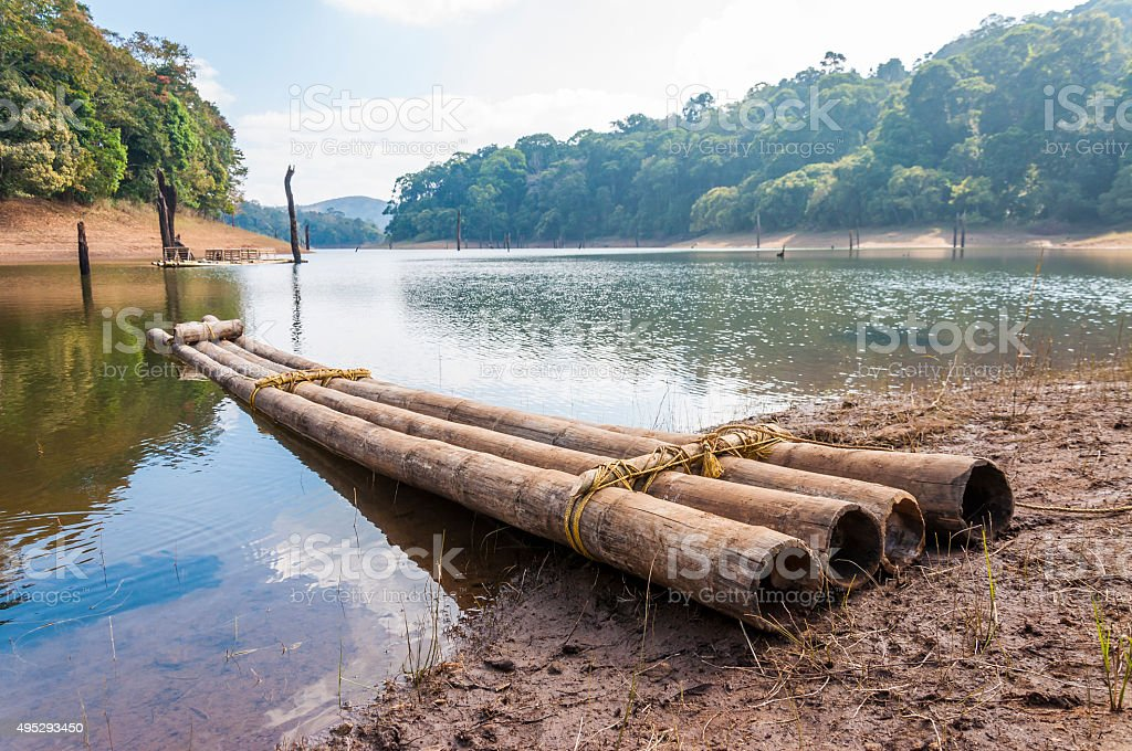 Scenic waterscape with bamboo raft in Periyar National Park, India. stock photo