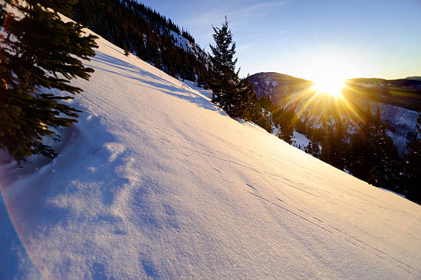 Scenic Winter Mountain Sunset Scenic Winter Mountain Sunset.  View of setting sun with warm late afternoon light.  Cool lens flare effect from using wide angle lens.  Captured as a 14-bit Raw file. Edited in ProPhoto RGB color space. beaver creek colorado stock pictures, royalty-free photos & images