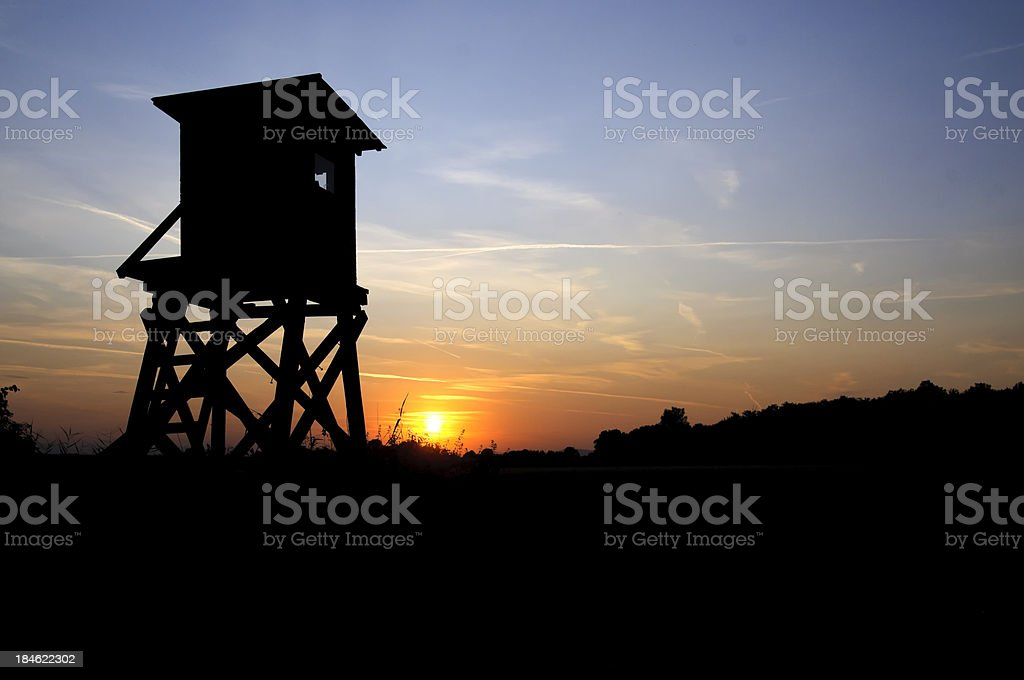 Scenic with silhouette of hunters blind stock photo