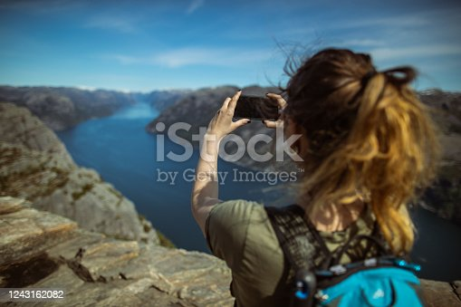 Scenics landmark of Norway: the mountain cliff on Preikestolen over fjord after the long Covid-19 lockdown