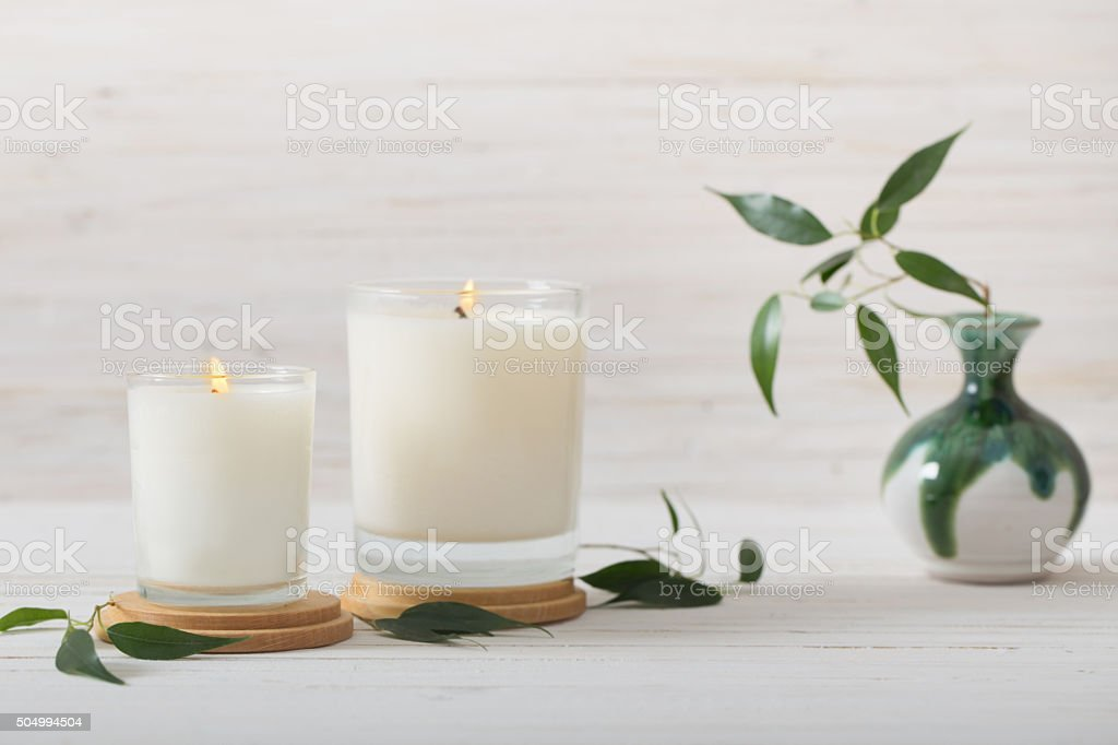 scented candles on white background stock photo