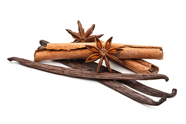 Scented Spices Scented Spices. Vanilla, Cinnamon and Star Anise Isolated on White Background star anise on white stock pictures, royalty-free photos & images