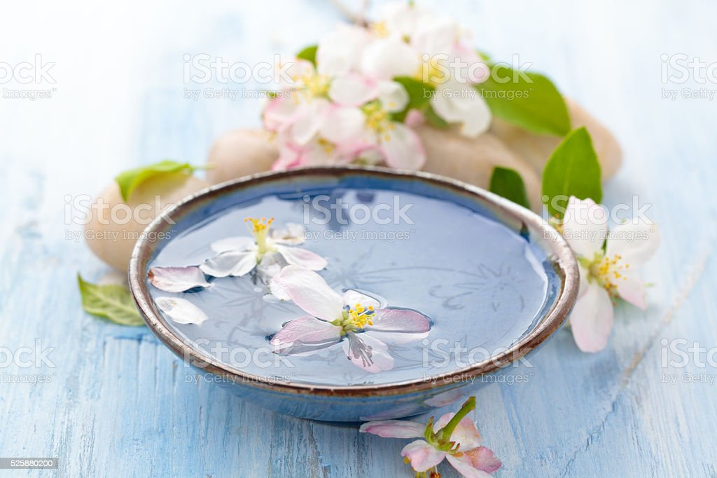 Scented water and flowers. stock photo