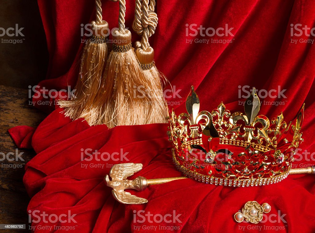 Scepter and crown on red velvet stock photo