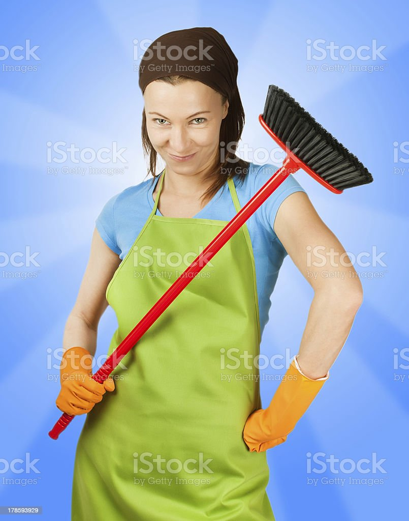 sceptic woman with broom royalty-free stock photo