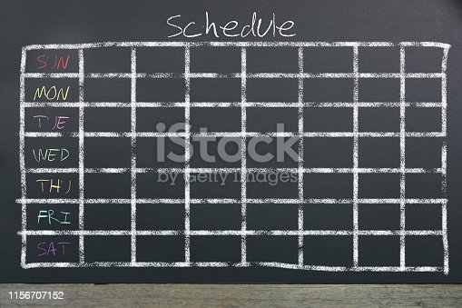 istock Schedule with grid time table on black chalkboard background 1156707152