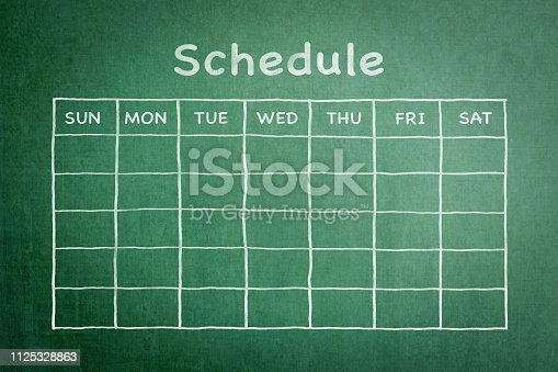 istock Schedule with grid timetable on green chalkboard 1125328863