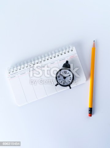 istock Scheduler, alarm clock and pen 696315454