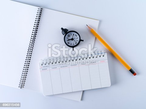 istock Scheduler, alarm clock and pen 696315456