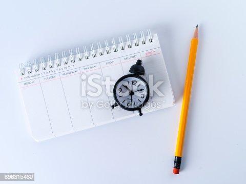 istock Scheduler, alarm clock and pen 696315460