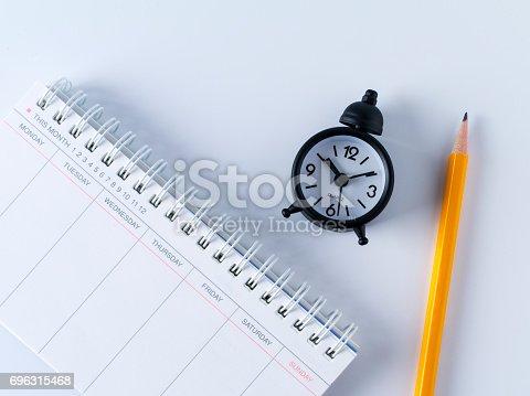 istock Scheduler, alarm clock and pen 696315468