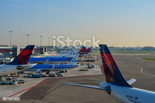 675796650 istock photo Schiphol Airport skydeck view, airplanes waiting the departure, KLM, Detla Airlines and another companies. 687091002