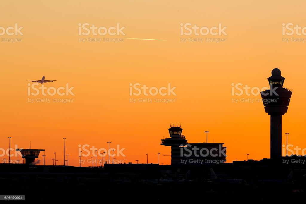 Schiphol airport sunset Amsterdam-Schiphol airport sunset  at a clear sky with departing airplane Air Vehicle Stock Photo