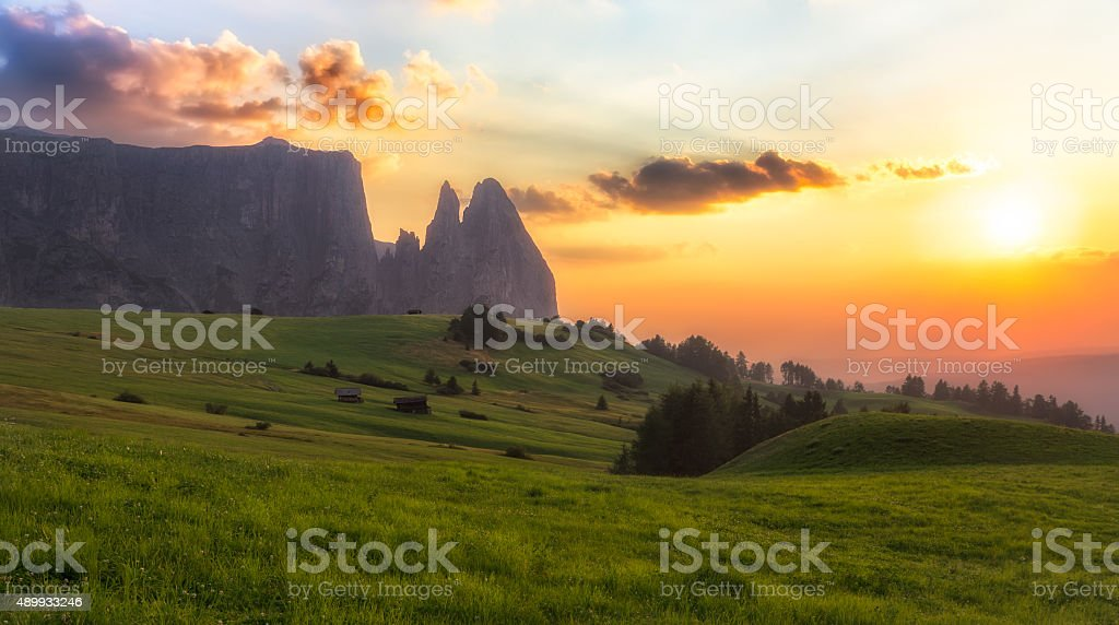 Schlern mountain with pasture at sunset, South Tyrol, Italy stock photo