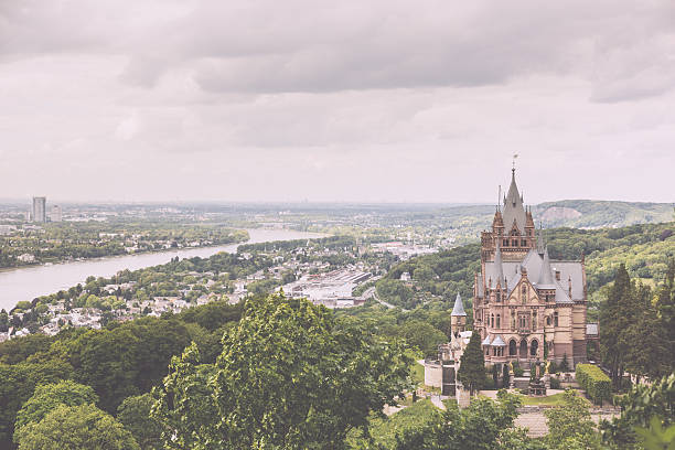 Schloss Drachenburg, Dragon Castle in Bonn Schloss Drachenburg, Dragon Castle in english, with city of Bonn in background and all the Rhine valley. north rhine westphalia stock pictures, royalty-free photos & images