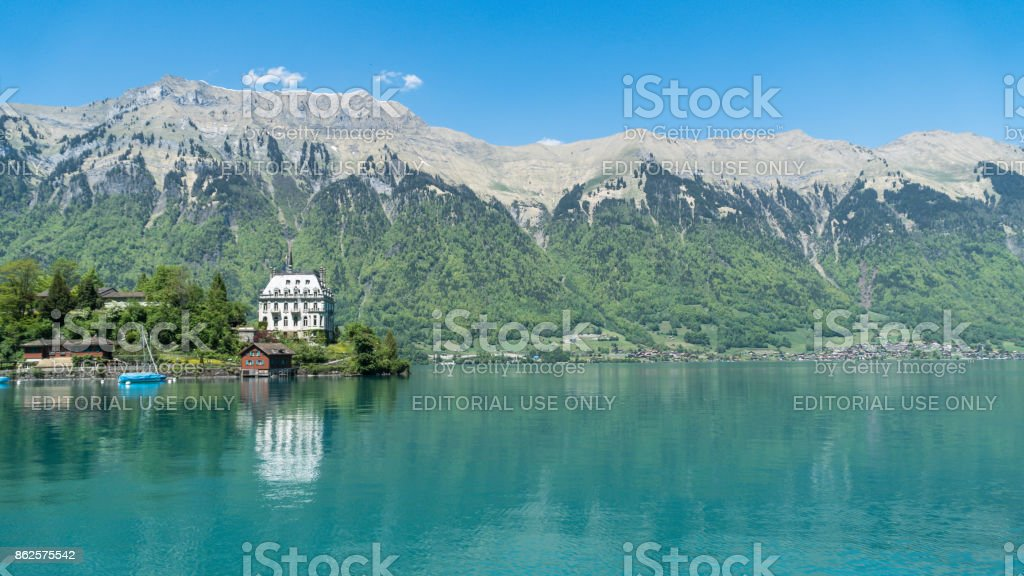 Schloss Seeburg, Seeburg castle, in Iseltwald with lake Brienz. stock photo