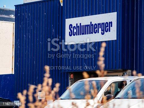 IJmuiden Santpoort Zuid, Netherlands: Schlumberger logotype on the facade of the local headquarter representation near petroleum port