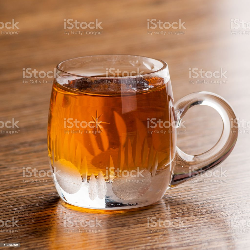 Schnapps in glass on wooden table stock photo