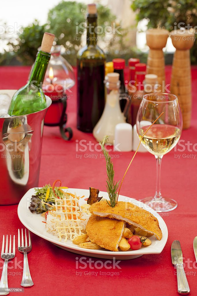Schnitzel and white wine royalty-free stock photo