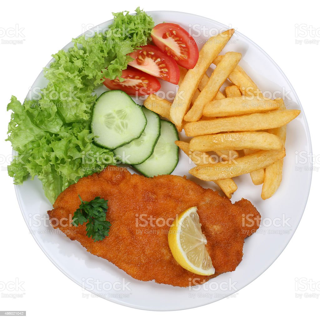 Schnitzel chop cutlet meal with french fries on plate isolated stock photo