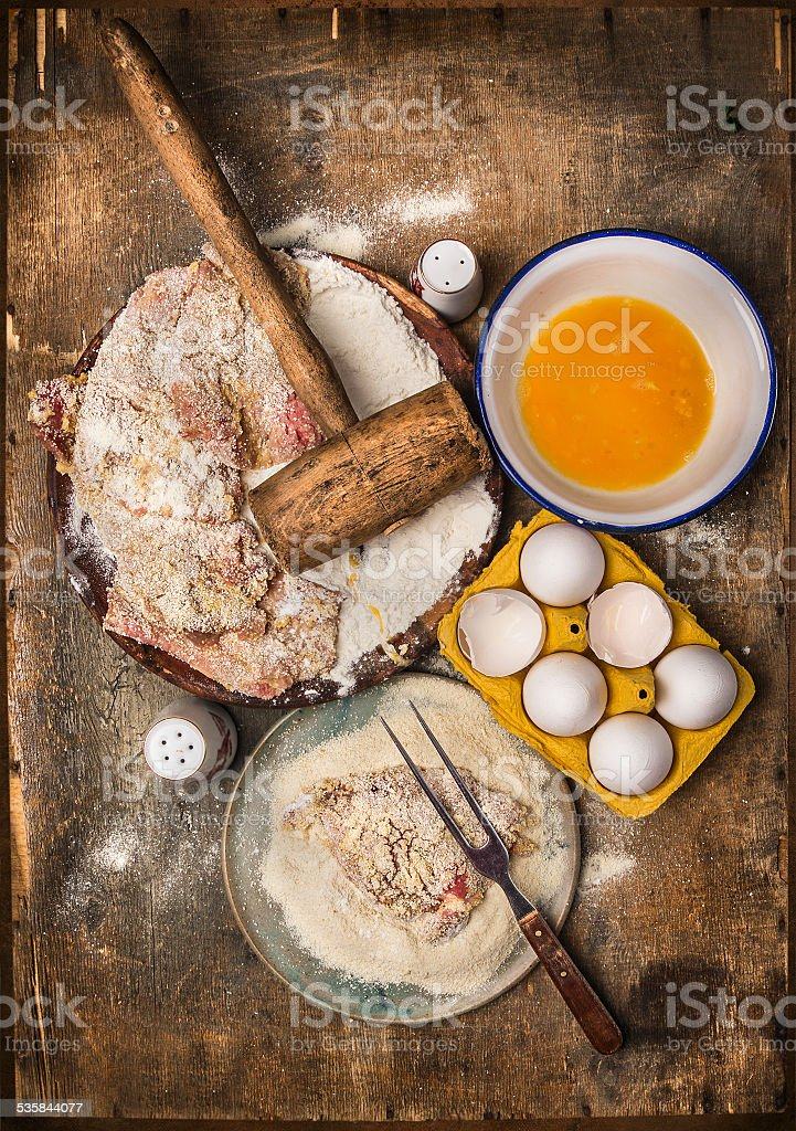 Schnitzel making, preparation composing with ingredients on wooden background stock photo