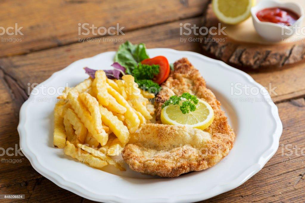 Schnitzel mit Pommes stock photo