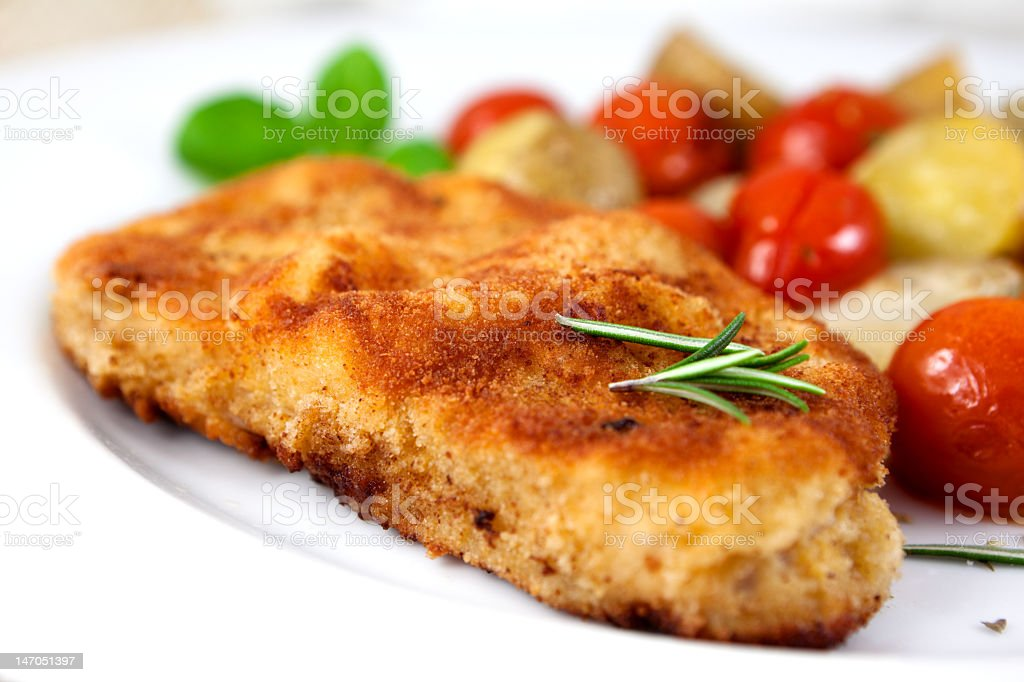 Schnitzel with baked vegetables and rosemary stock photo