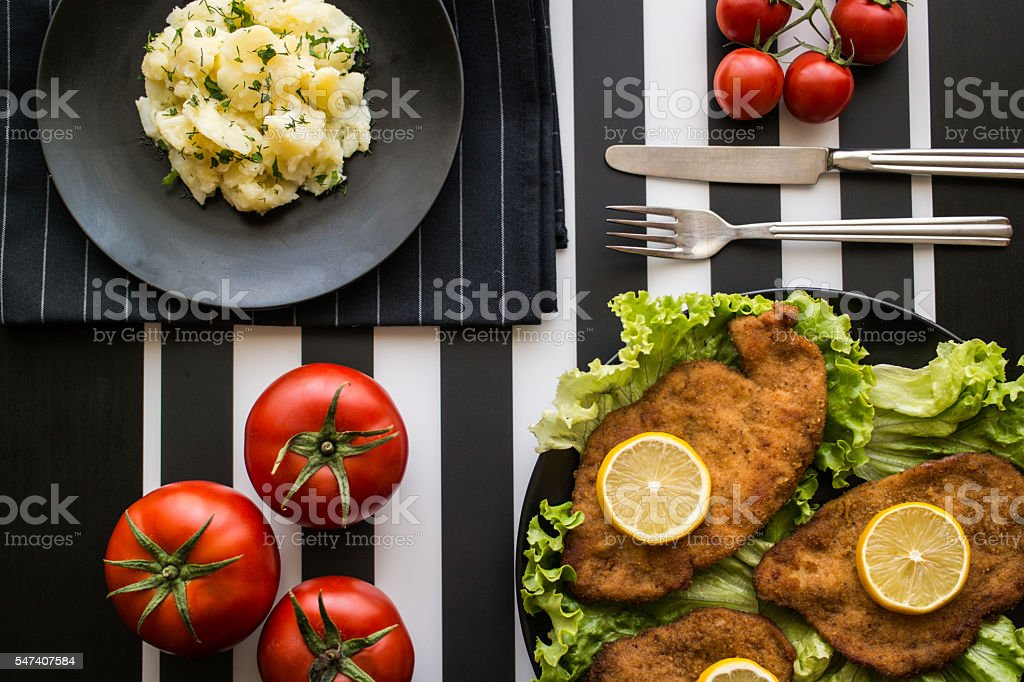schnitzel with potato salad stock photo