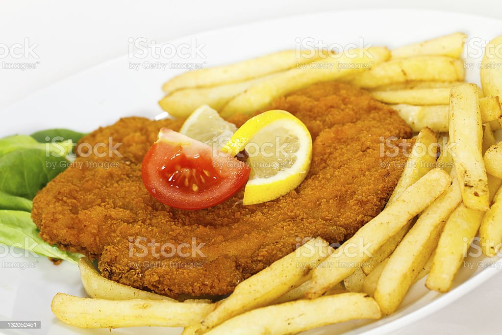 Schnitzel,fresh breaded,with french Fries stock photo