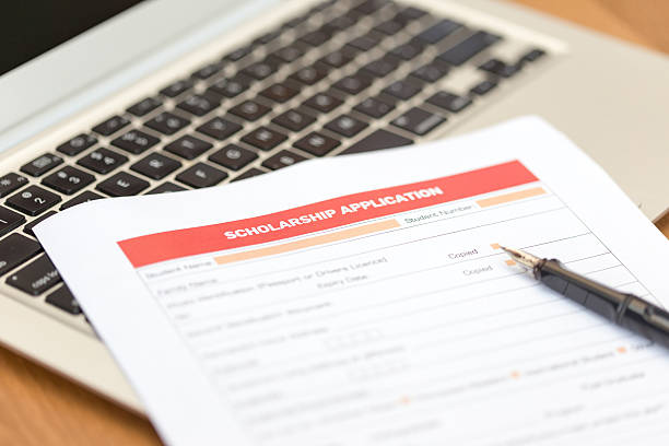 Scholarship Application Form on Desk – Foto