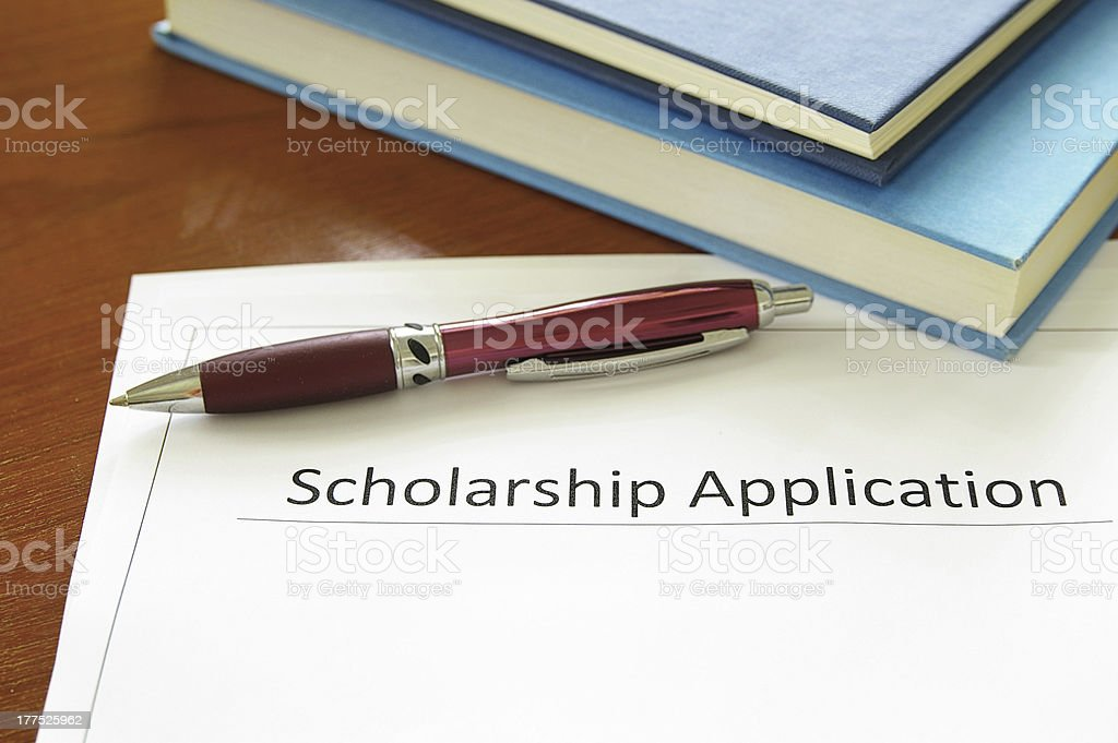 Scholarship application form with pen on top stock photo