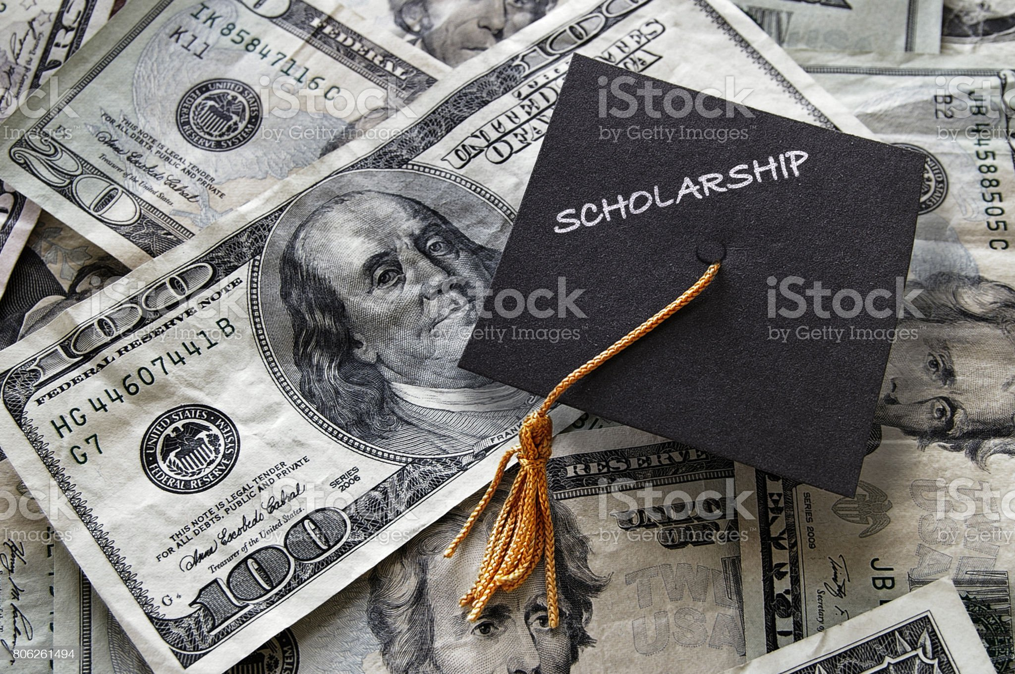 Scholarship graduation cap on cash Scholarship mini graduation cap on  cash Studying Stock Photo