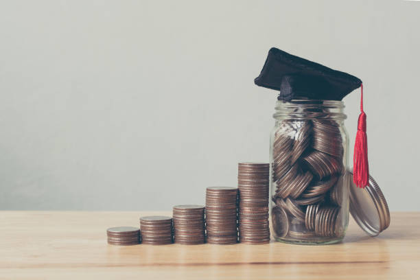 scholarship money concept. coins in jar with money stack step growing growth saving money investment - university stock pictures, royalty-free photos & images