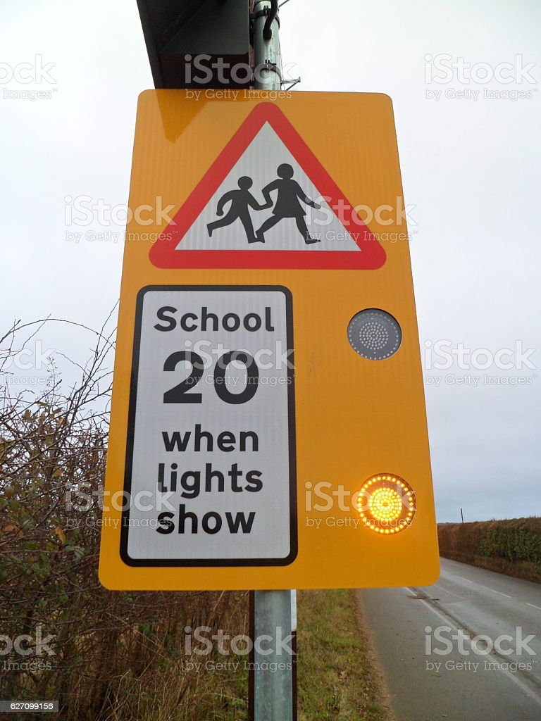 'School 20 when lights show' speed limit sign stock photo