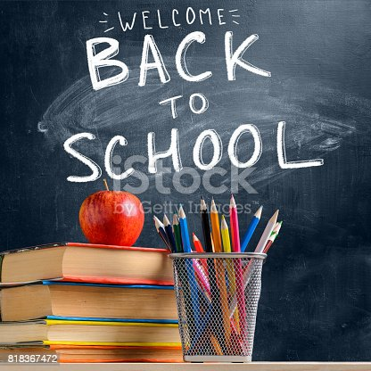 istock School accessories against blackboard 818367472