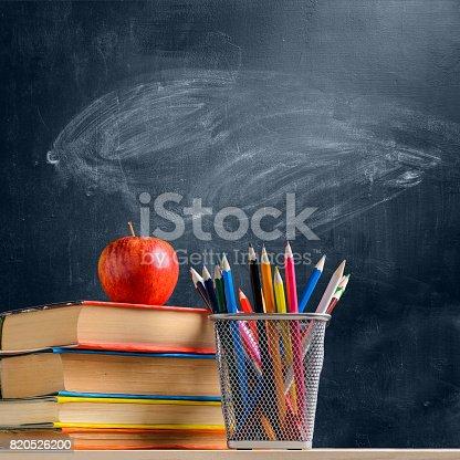 istock School accessories against blackboard 820526200