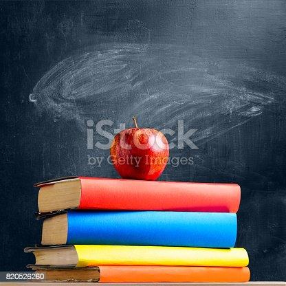 istock School accessories against blackboard 820526260