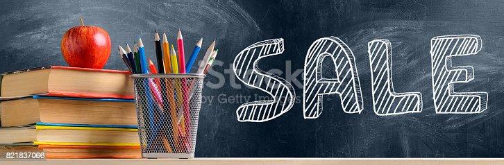 istock School accessories against blackboard 821837066