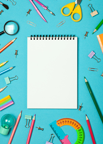 istock School accessories and office stationery and emty notrbook on green background. 1198571727