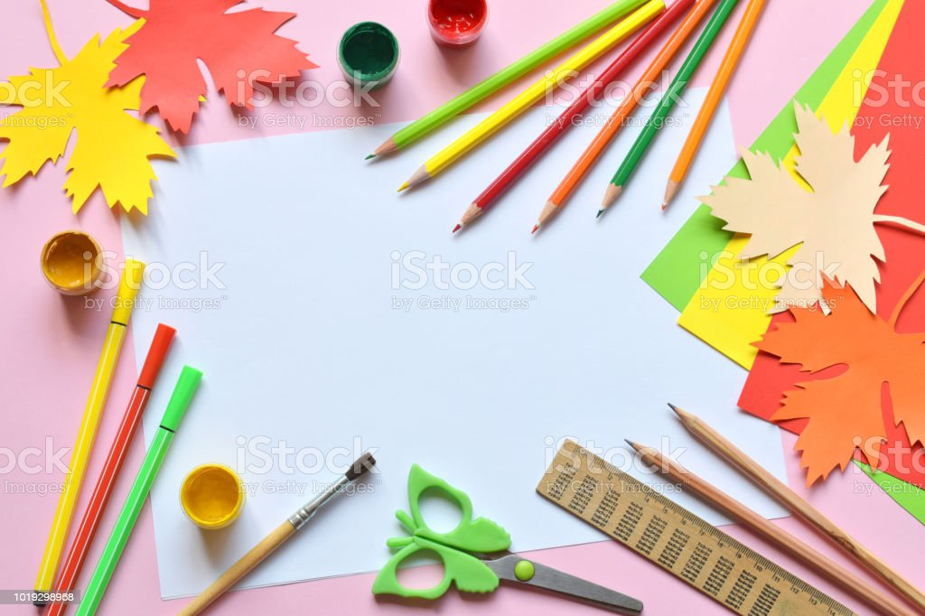 School accessories and supplies: pencils, paint, ruler, paper maple leaf, scissors on a light background. Back to school concept. Hello Autumn. Handmade crafts. Children's DIY. Flat lay. Copy space stock photo