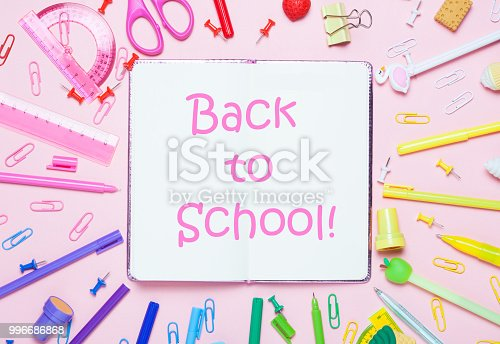 istock School accessories are laid out in the form of a rainbow and notrbook. 996686868