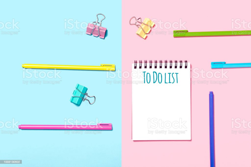 School accessories are laid out in the form of a rainbow and To Do list notrbook. stock photo