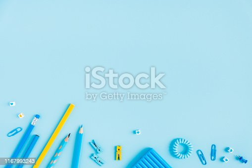 istock School accessories on a blue background. Pastel colored. 1167993243