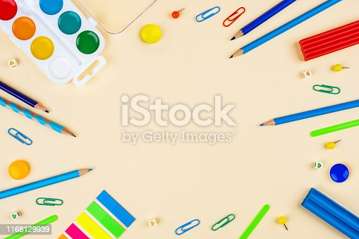 istock School accessories on a yellow background. Pastel colored. 1168129939